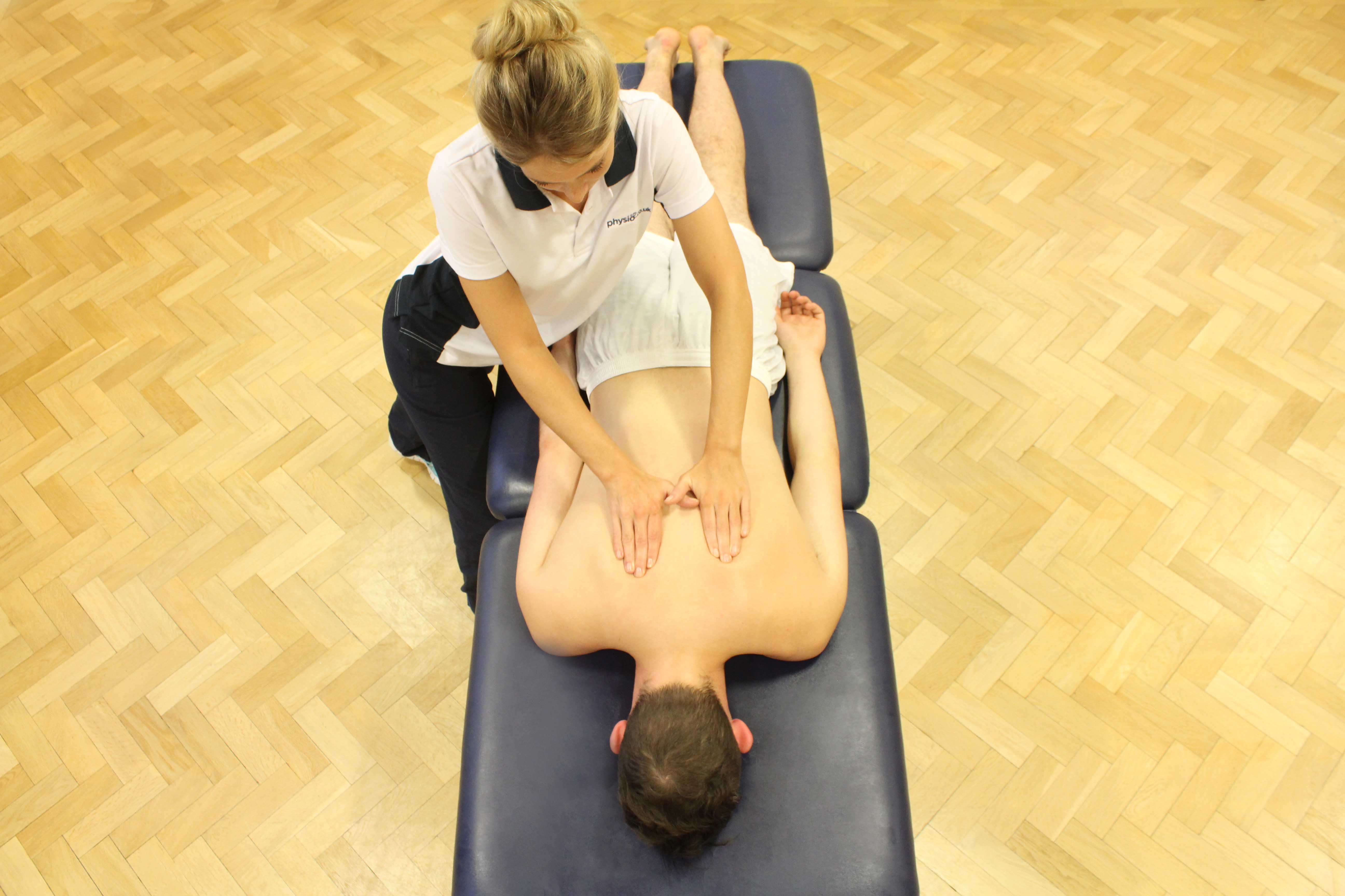 Soft tissue massage of the upper thoracic spine