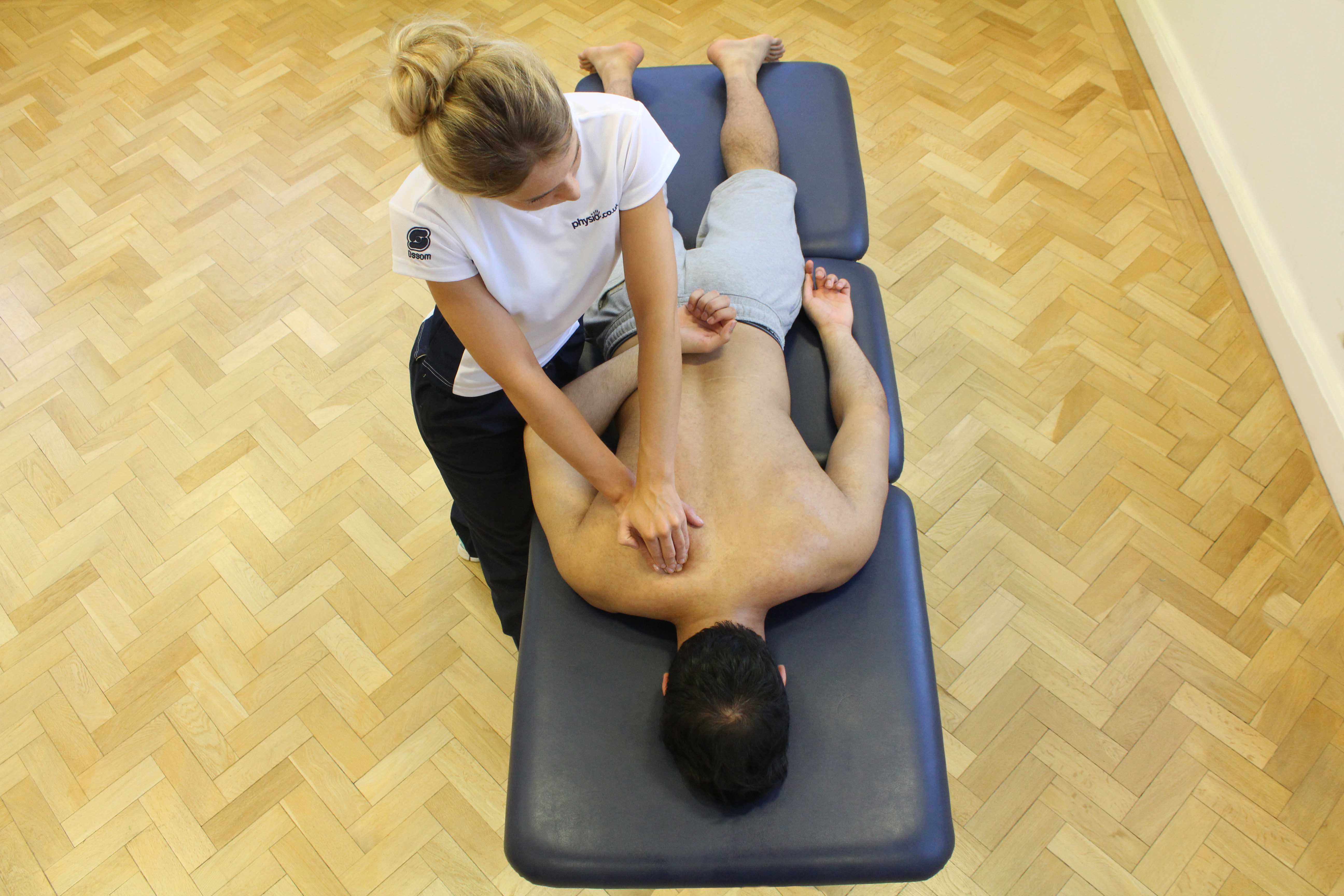 Soft tissue massage of upper back muscles