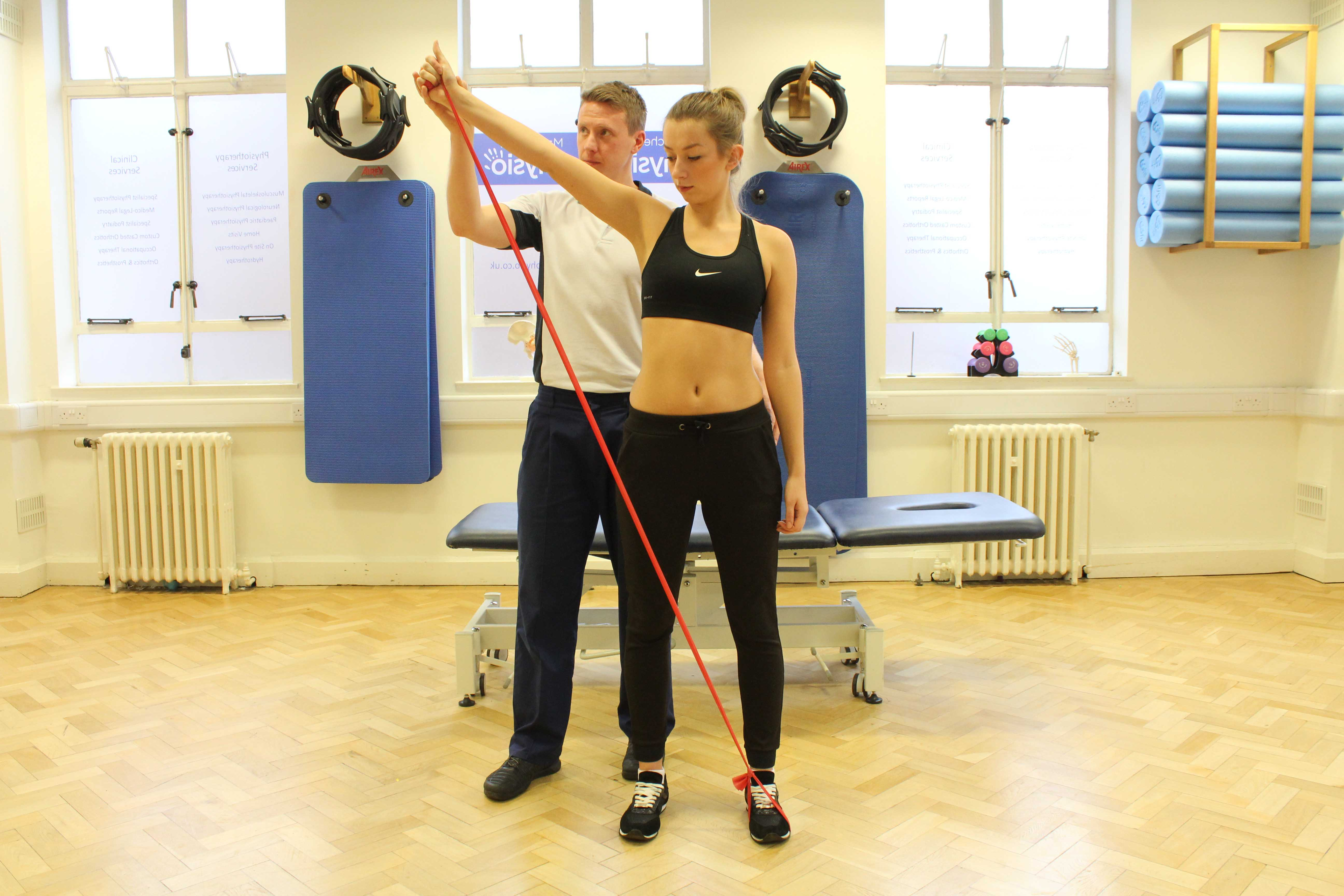 Shoulder toning exercises supervised by experienced physiotherapist