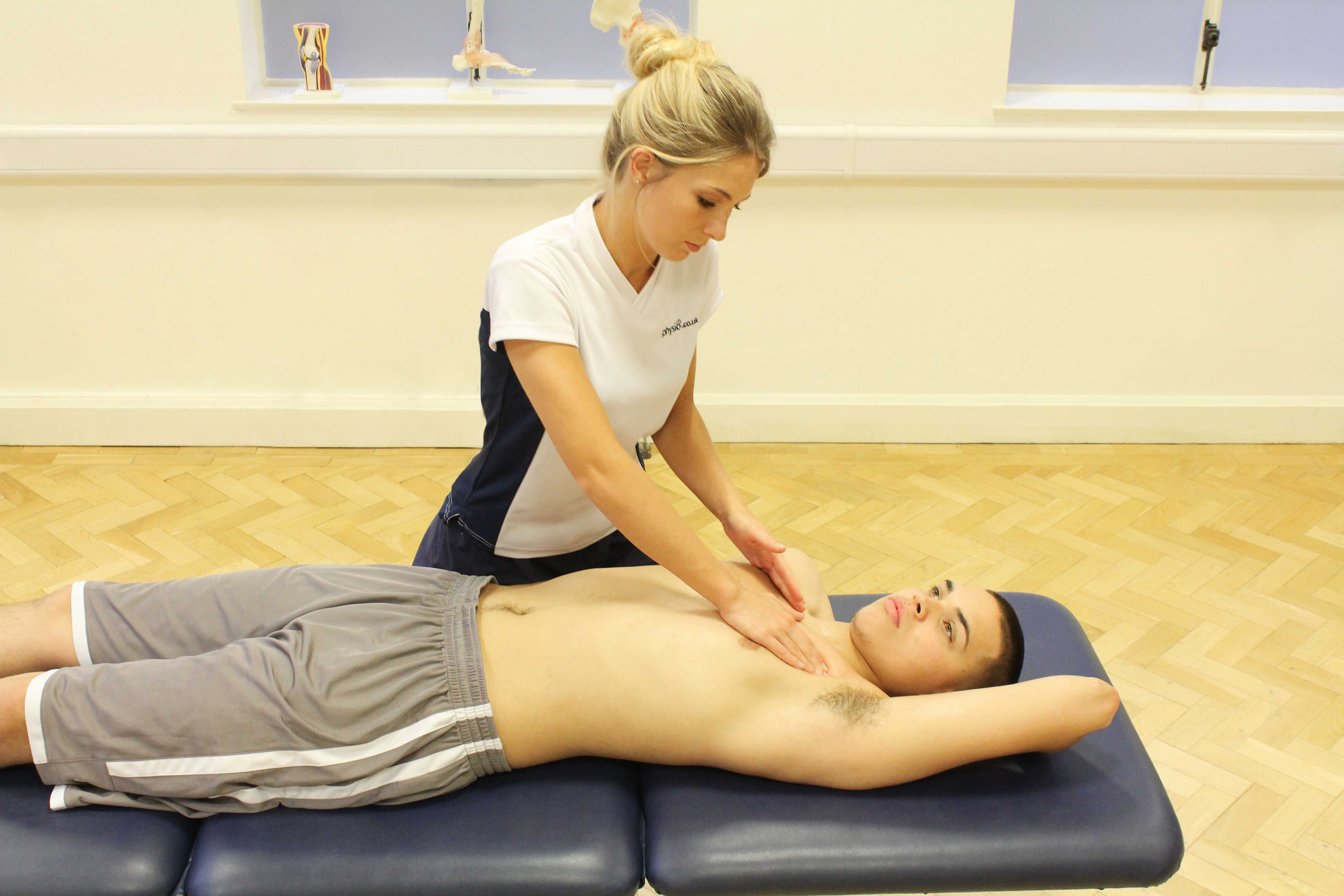 Soft tissue massage of the chest muscle and connective tissues by specialist MSK therapist