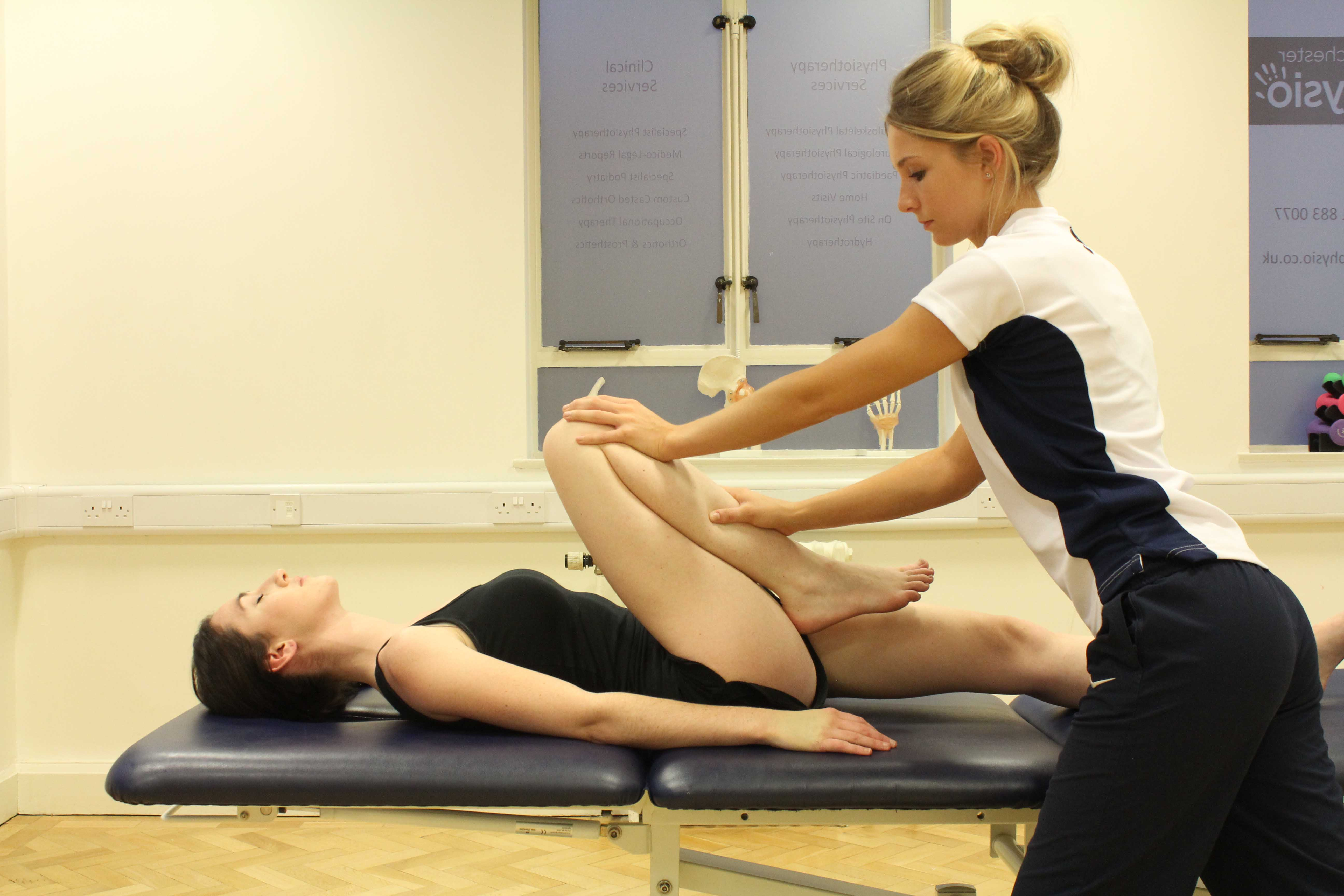 Massage and stretch of acetabular joint to ease tight hip muscles