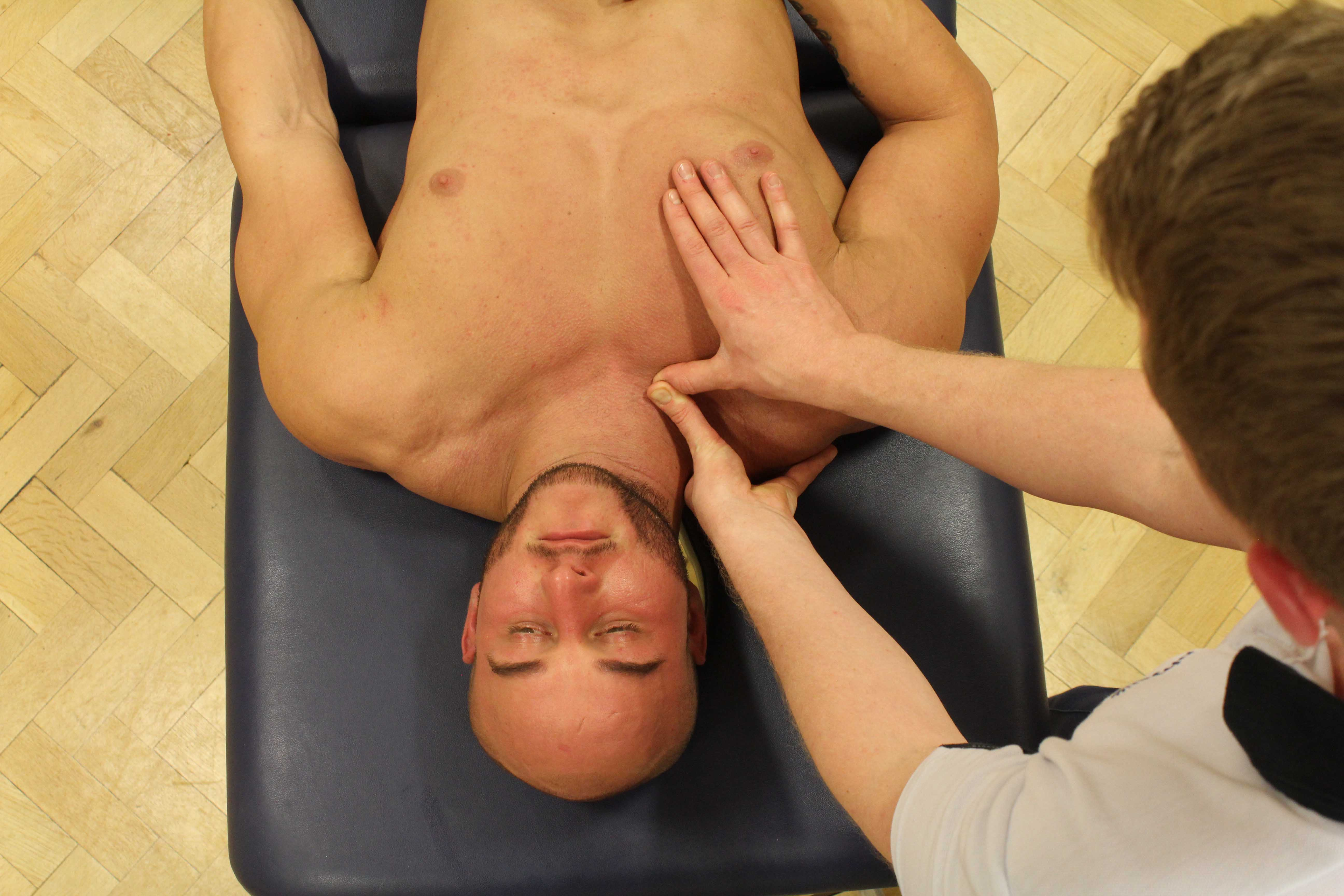 Trigger point massage applied to the chest muscles by a specialist MSK therapist