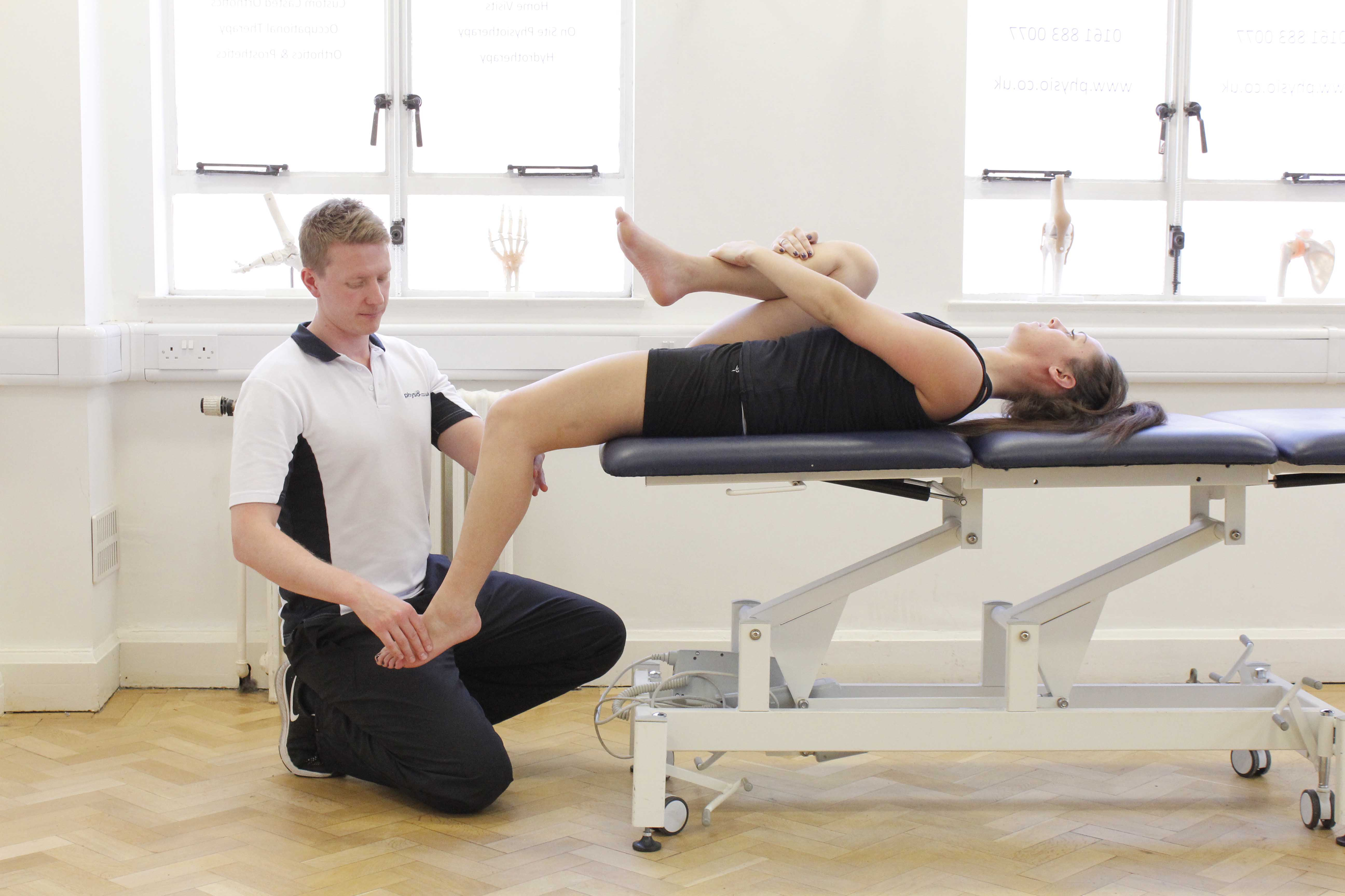 Passive stretch of the quadricep muscles by a specialist MSK physiotherapist