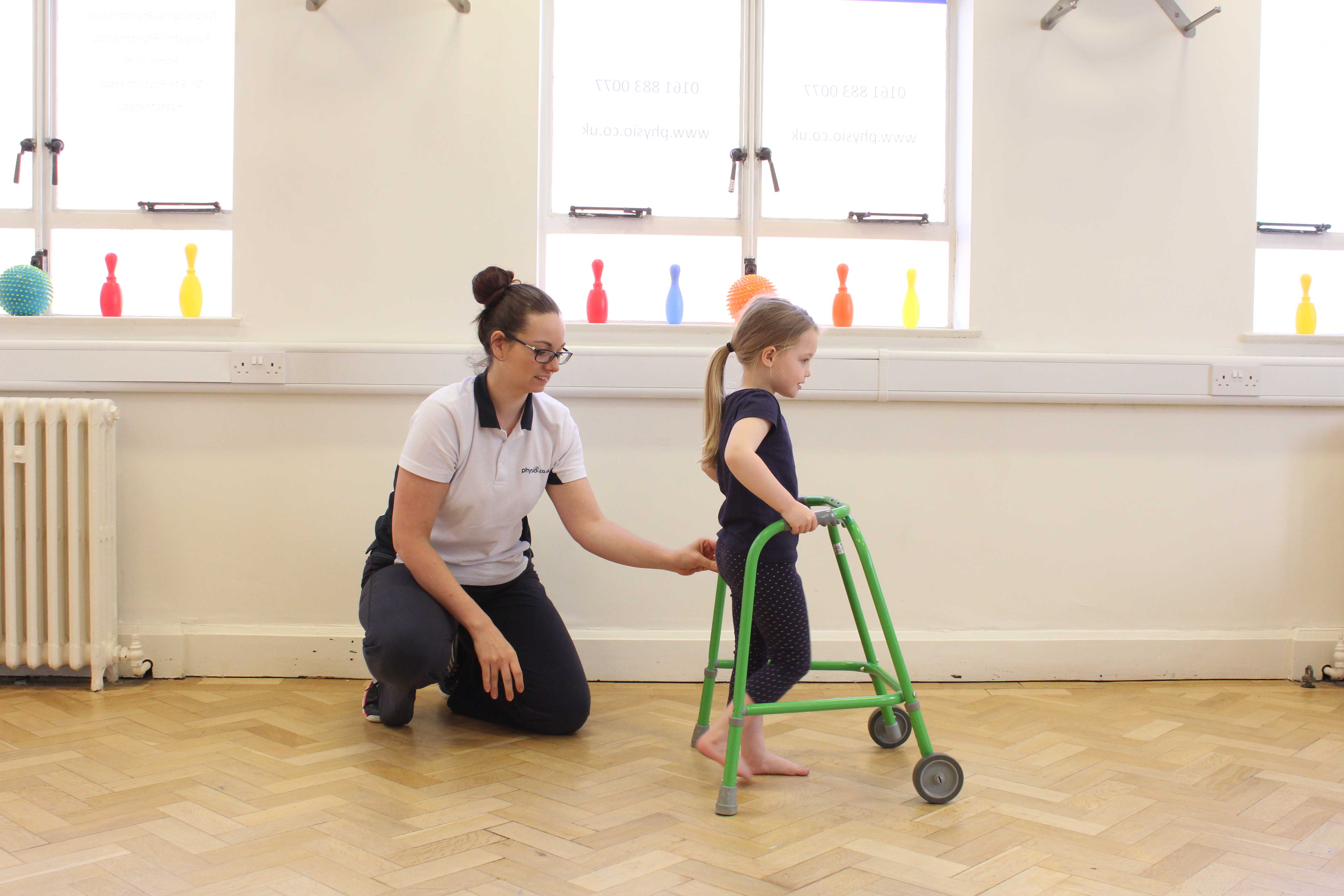 Mobility exercises supported by a trunk orthotic and wheeled walking frame