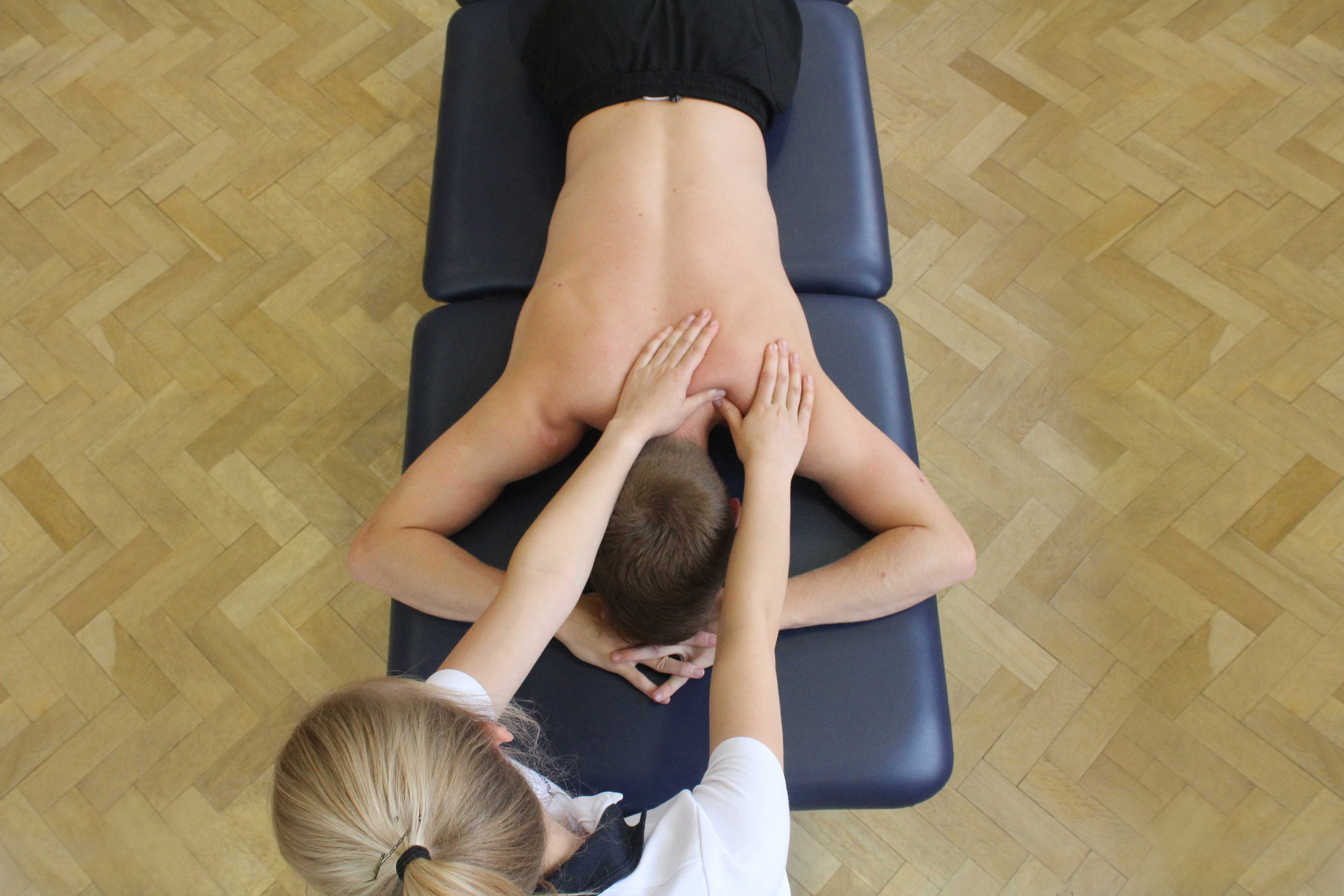 Soft tissue massage of trapezius muscle