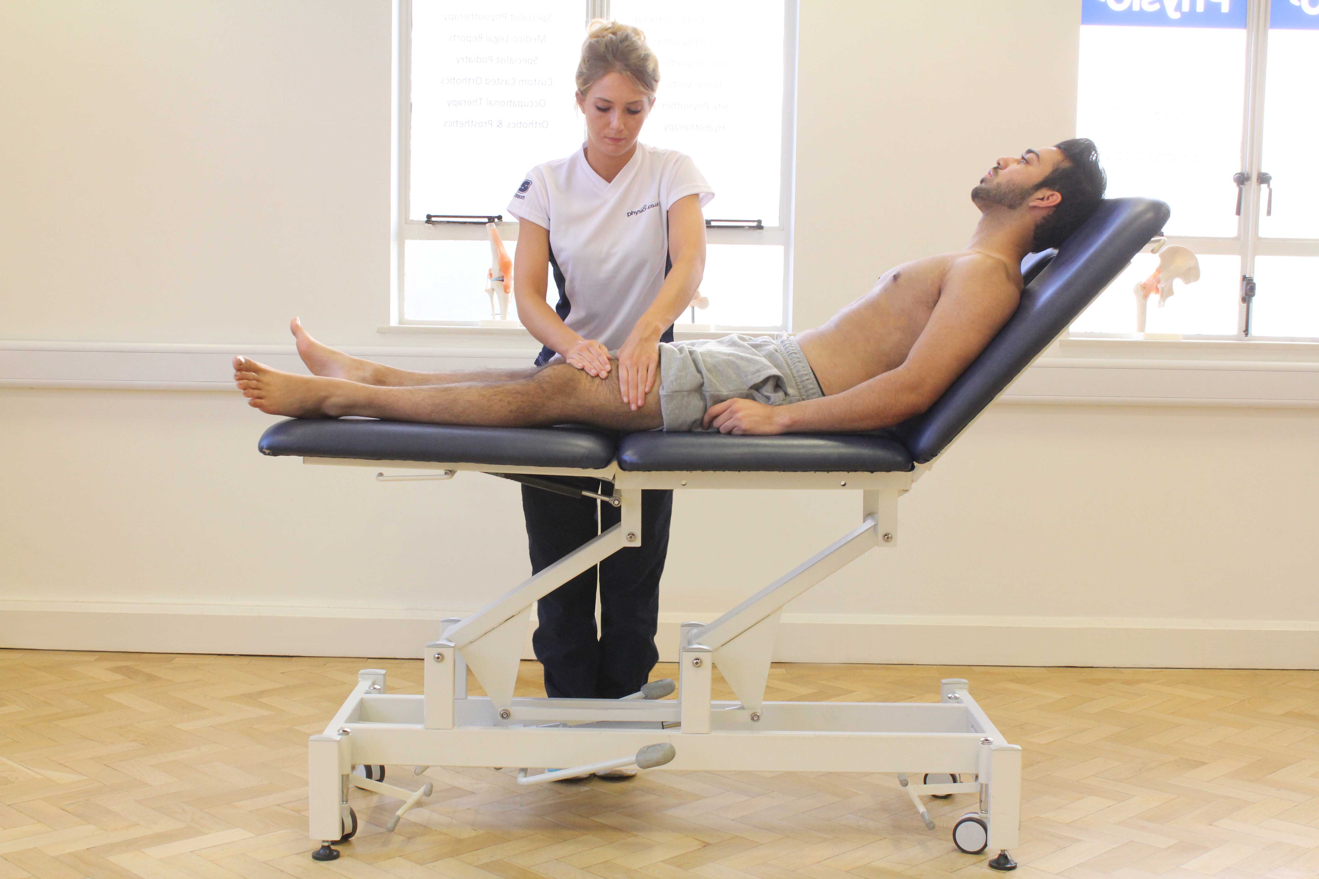 Rolling soft tissue massage of the quadricep muscles by experienced therapist