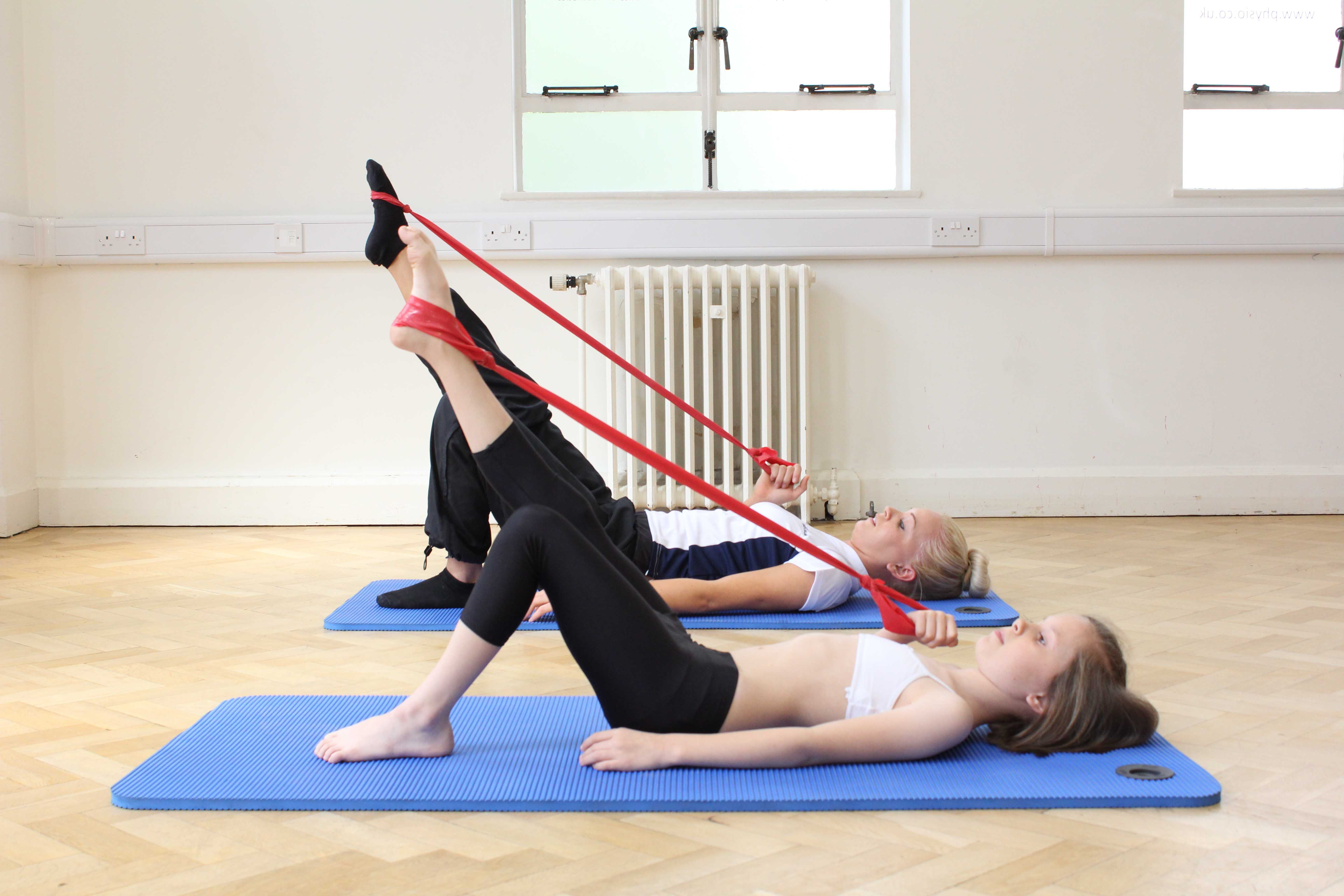 Toning and strengthening exercises for the leg using a resistance band