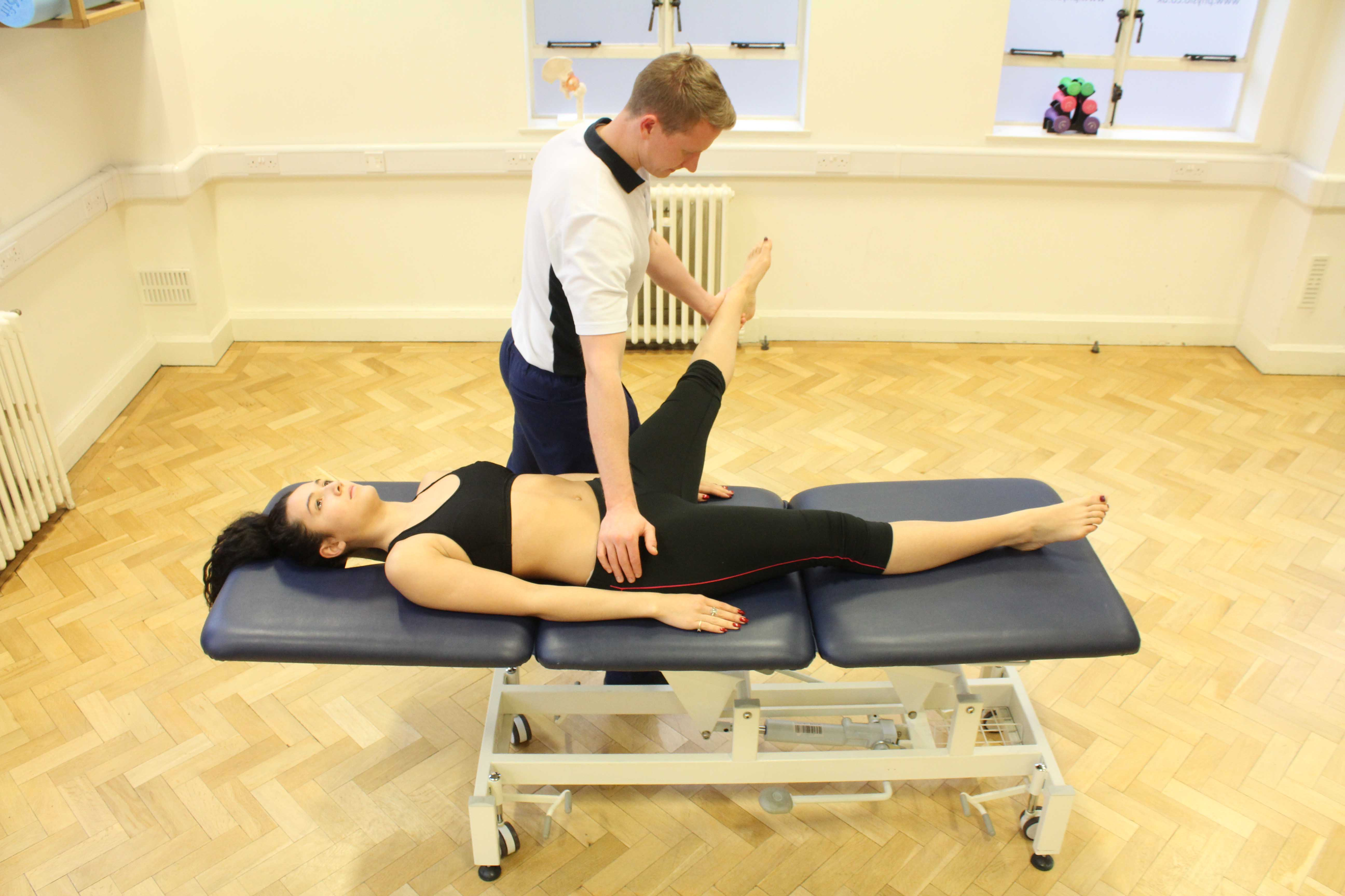 Passive mobilisations and stretches of the hip and knee by a specilaist physiotherapist