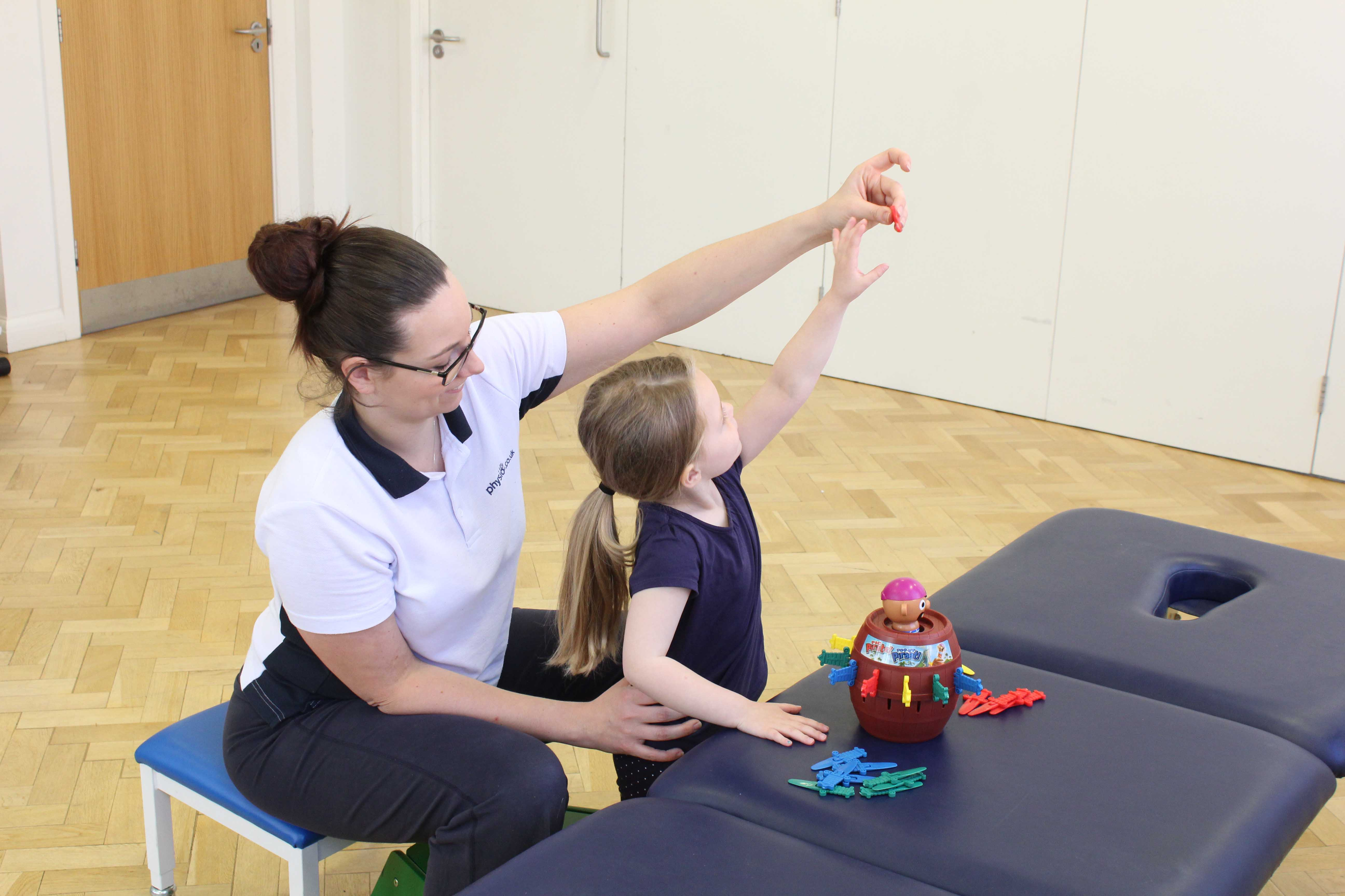 Developing fine motor skills through play activities supervised bya paediatric physiotherapist