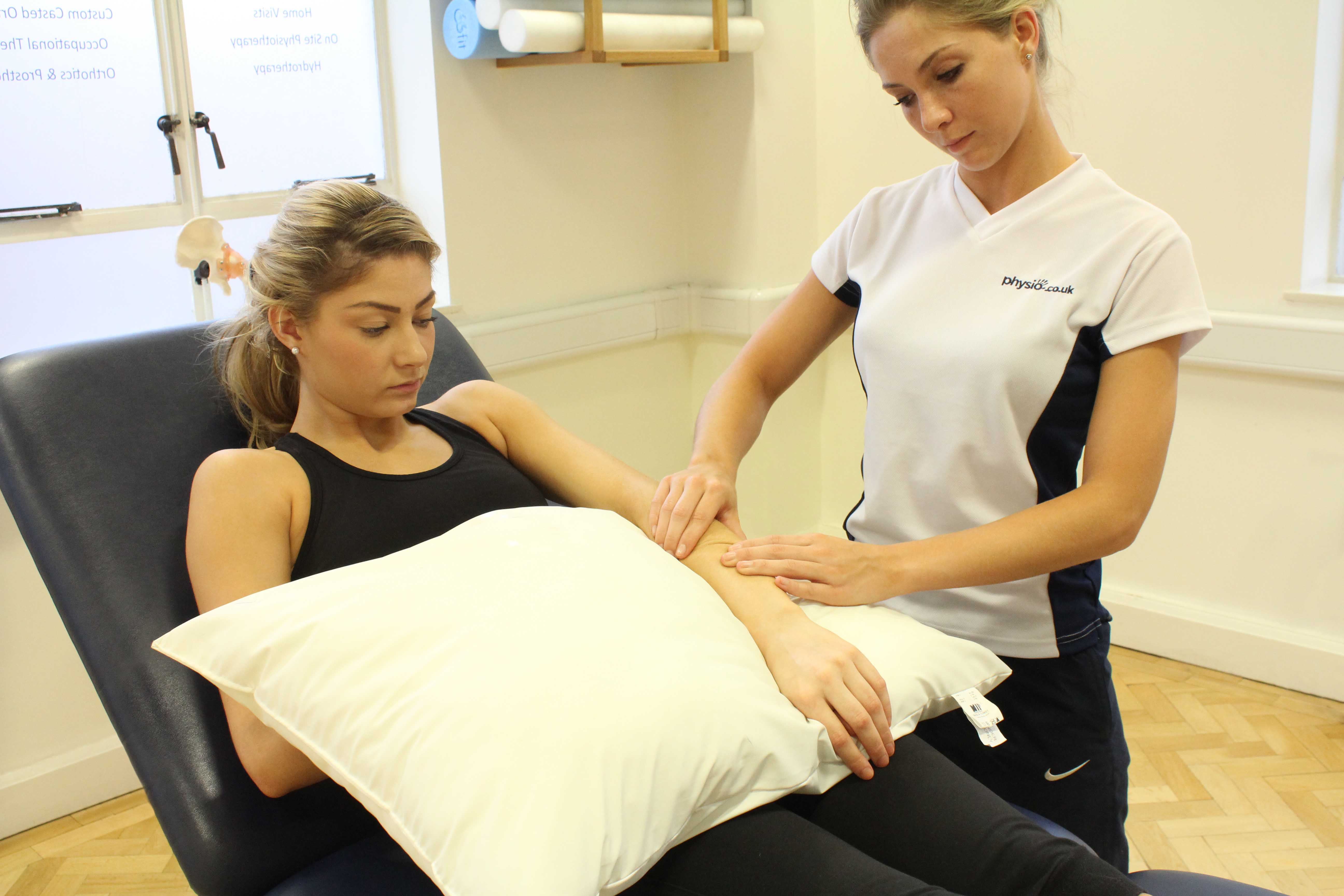 Soft tissue massage of the muscle and tendons in the forearm